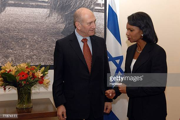 In this handout image provided by the Israeli Government Press Office , Israeli Prime Minister Ehud Olmert speaks with U.S. Secretary of State...