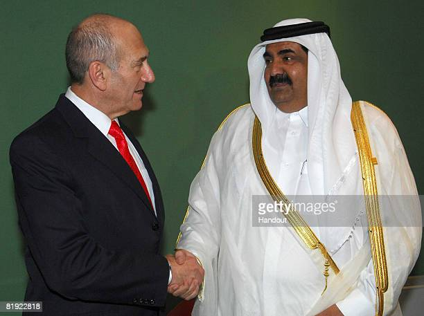 In this handout image provided by the Israeli Government Press Office, Israeli Prime Minister Ehud Olmert meets with Qatar's Emir Sheikh Hamad bin...
