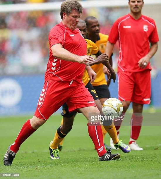 In this handout image provided by the ITM Group Jan Molby controls the ball during the Legends match between Liverpool FC Legends and Kaizer Chiefs...
