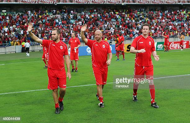 In this handout image provided by the ITM Group Jason McAteer Rob Jones and Steve McManaman of Liverpool FC Legends during the Legends match between...