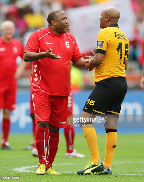 In this handout image provided by the ITM Group John Barnes and Doctor Khumalo talk during the Legends match between Liverpool FC Legends and Kaizer...