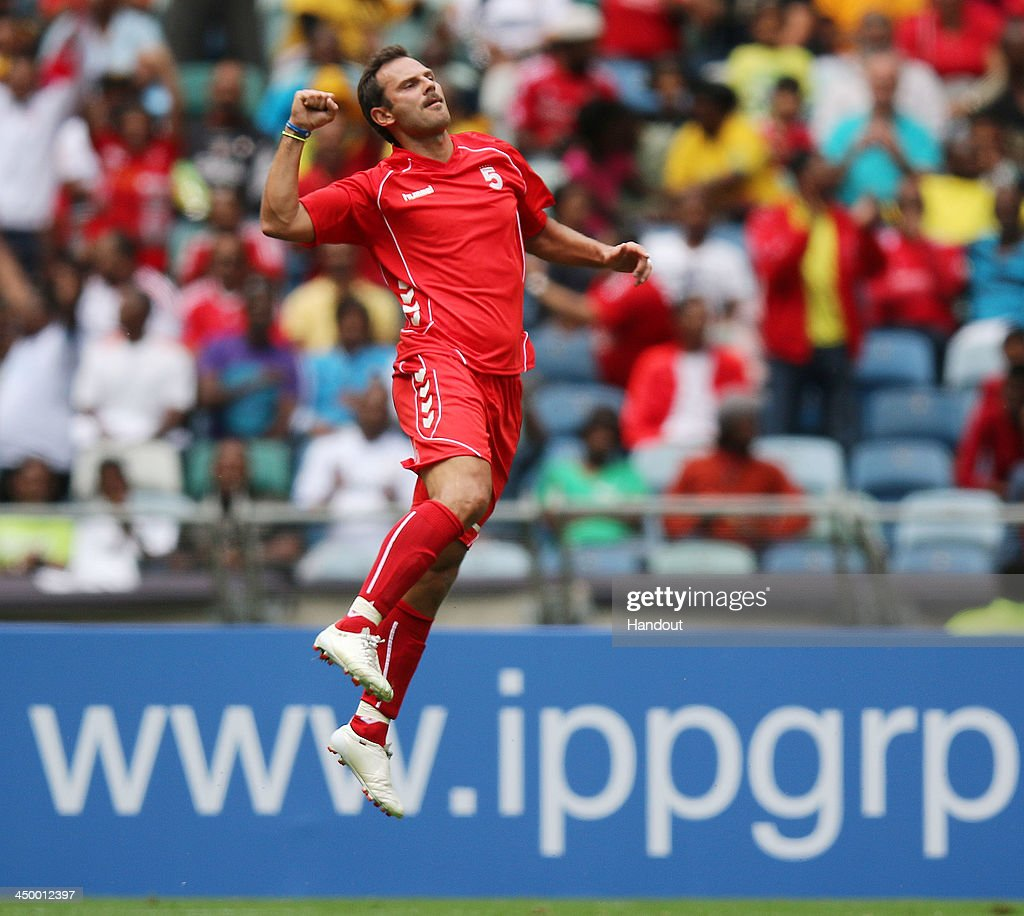 In this handout image provided by the ITM Group, Patrik Berger celebrates a goal during the Legends match between Liverpool FC Legends and Kaizer Chiefs Legends at Moses Mabhida Stadium on November 16, 2013 in Durban, South Africa.