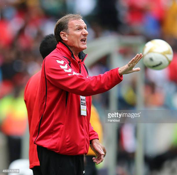 In this handout image provided by the ITM Group Phil Thompson of Liverpool Legends makes a point during the Legends match between Liverpool FC...