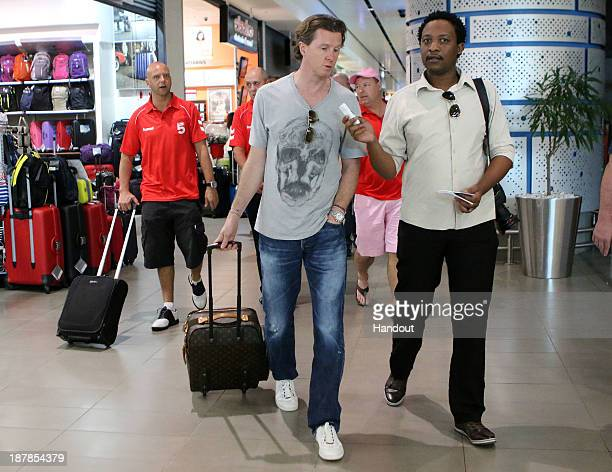 In this handout image provided by the ITM Group Steve Macmanaman is interviewed by media during the Liverpool FC Legends Tour arrival at King Shaka...