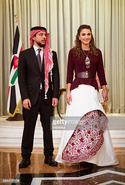 In this handout image provided by the Jordanian Royal Household Queen Rania of Jordan poses with Crown Prince Al Hussein bin Abdullah II of Jordan as...