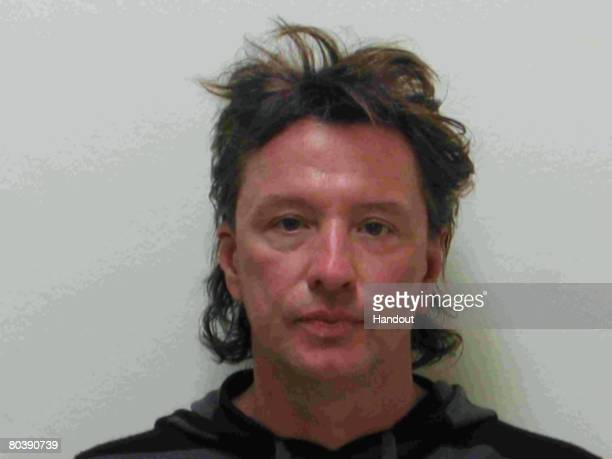 In this handout image provided by the Laguna Beach Police Department Bon Jovi guitarist Richard Sambora poses for his mug shot March 26 2008 in...