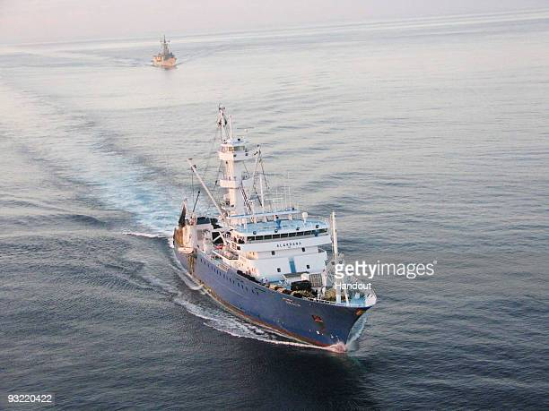 In this handout image provided by the Ministerio de Defensa de Espana Spanish warships escort the 'Alakrana' fishing vessel on November 17 2009 on...