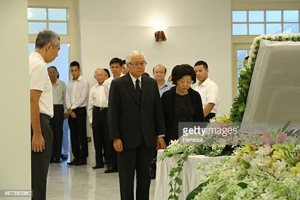 In this handout image provided by the Ministry of Communications and Information of Singapore President Tony Tan and Mrs Tan pay their respects to Mr...
