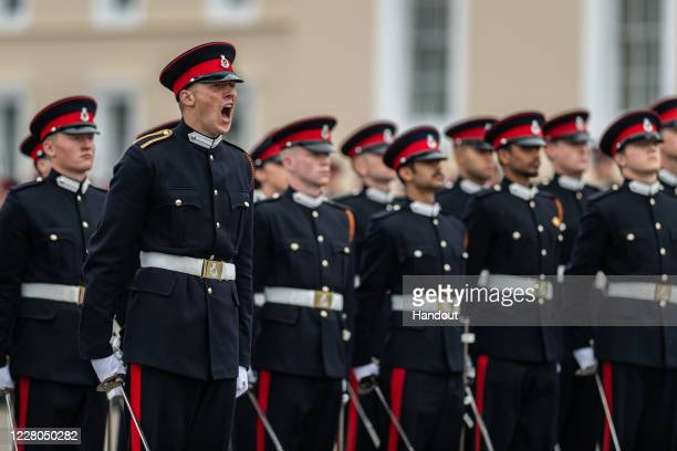 In this handout image provided by the Ministry of Defence 213 Officer Cadets from Commissioning Course 193 are passed out as Army officers during the...