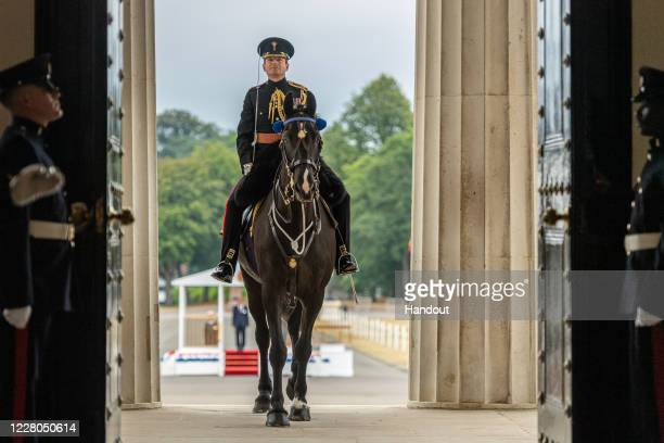 In this handout image provided by the Ministry of Defence, 213 Officer Cadets from Commissioning Course 193 are passed out as Army officers during...