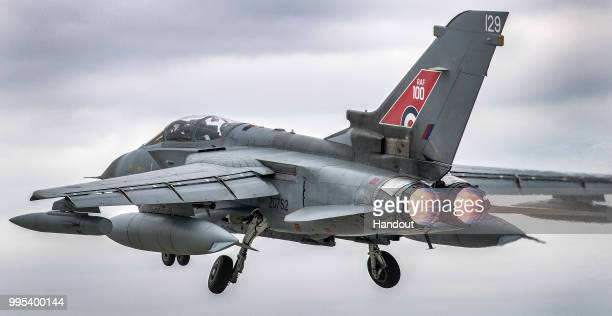 In this handout image provided by the Ministry of Defence an Royal Air Force Tornado taking off from RAF Marham to join the RAF100 centenary flypast...