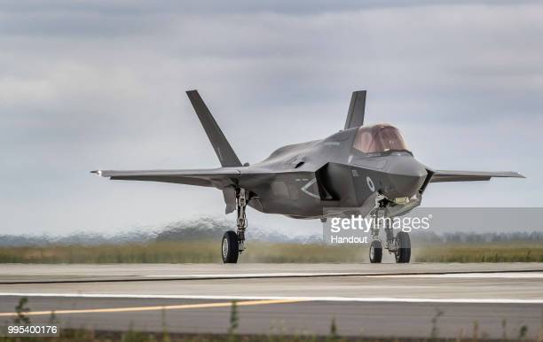 In this handout image provided by the Ministry of Defence an Royal Air Force F35 Lightning from 617 Sqn taking off from RAF Marham to join the RAF100...