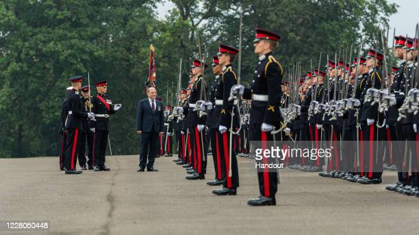 In this handout image provided by the Ministry of Defence Defence Secretary Ben Wallace representing Her Majesty The Queen acts as Inspecting Officer...