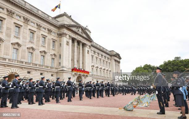 In this handout image provided by the Ministry of Defence RAF Personnel parade within the grounds of Buckingham Palace during RAF 100 celebrations on...