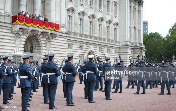 In this handout image provided by the Ministry of Defence RAF personnel performing drills within the grounds of Buckingham Palace whilst the Queen...