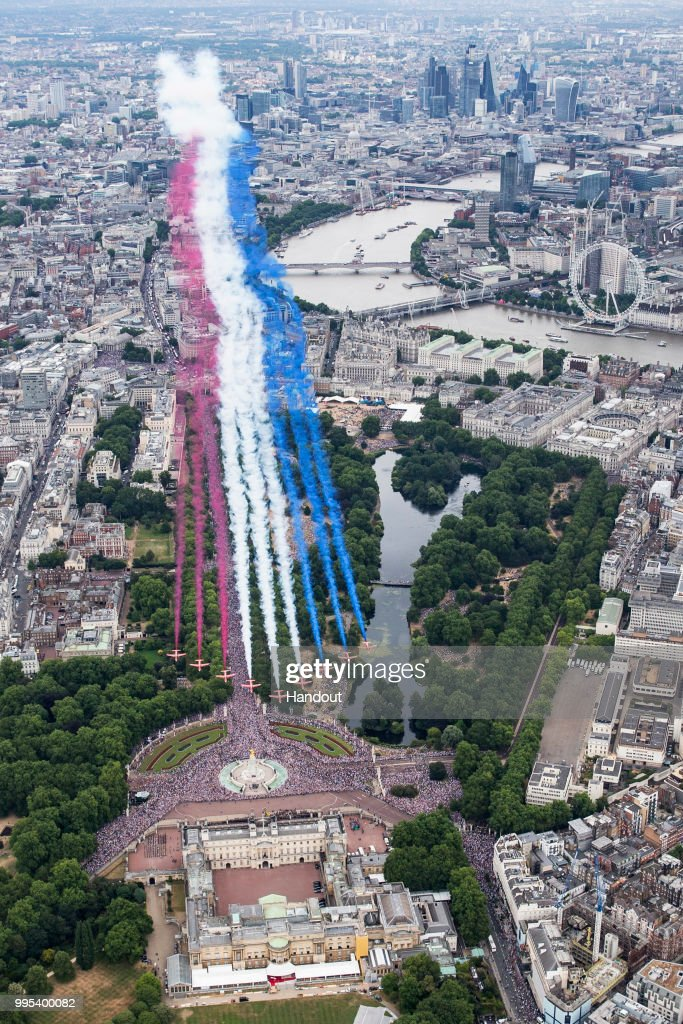 In this handout image provided by the Ministry of Defence, Red Arrows taking part in the RAF100 parade and flypast over London during RAF 100 celebrations on July 10, 2018 in London, England. A centenary parade and a flypast of up to 100 aircraft over Buckingham Palace takes place today to mark the Royal Air Forces' 100th birthday.