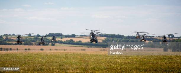 In this handout image provided by the Ministry of Defence Royal Air Force Puma 2 helicopters based at RAF Benson and Chinooks from Benson and RAF...