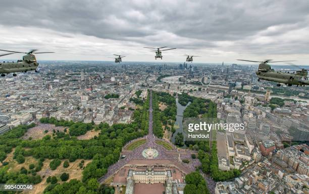 In this handout image provided by the Ministry of Defence Royal Air Force Chinooks from RAF Odiham flew in the lead formation along with Pumas from...