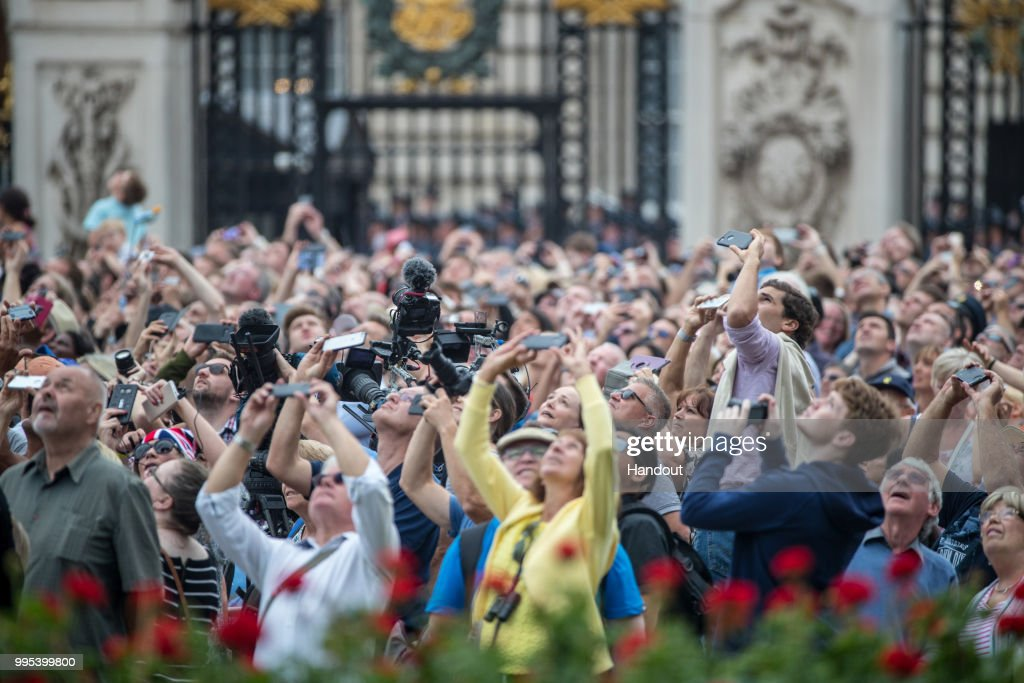 In this handout image provided by the Ministry of Defence, the crowd takes photos during RAF 100 celebrations on July 10, 2018 in London, England. A centenary parade and a flypast of up to 100 aircraft over Buckingham Palace takes place today to mark the Royal Air Forces' 100th birthday.