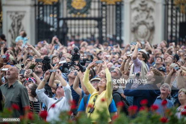 In this handout image provided by the Ministry of Defence the crowd takes photos during RAF 100 celebrations on July 10 2018 in London England A...
