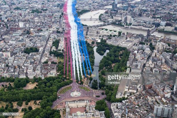 In this handout image provided by the Ministry of Defence the Red Arrows perform for the RAF100 flypast over London during RAF 100 celebrations on...