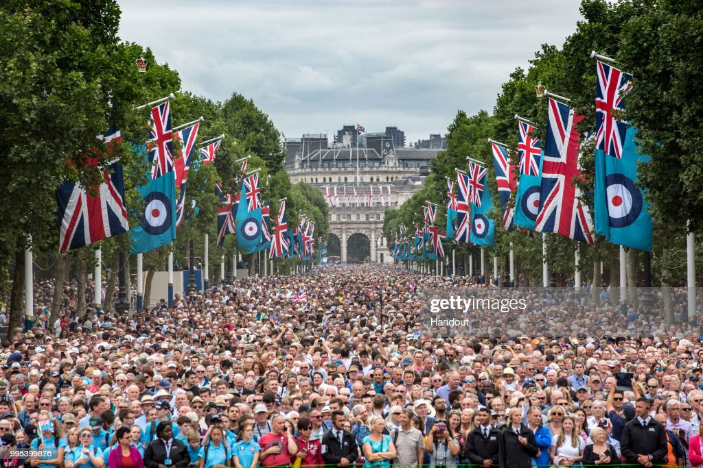 In this handout image provided by the Ministry of Defence, thousands of people fill the Mall waiting to see the RAF 100 flypast during RAF 100 celebrations on July 10, 2018 in London, England. A centenary parade and a flypast of up to 100 aircraft over Buckingham Palace takes place today to mark the Royal Air Forces' 100th birthday.