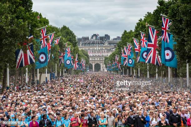 In this handout image provided by the Ministry of Defence thousands of people fill the Mall waiting to see the RAF 100 flypast during RAF 100...