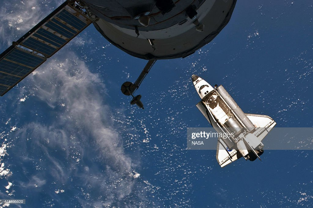In this handout image provided by the National Aeronautics and Space Administration (NASA), NASA space shuttle Atlantis in Earth orbit just before docking for the last time with the International Space Station July 10, 2011 in space. Atlantis has embarked on a 12-day mission to the International Space Station where it will deliver the Raffaello multi-purpose logistics module packed with supplies and spare parts. This will be the final launch of the space shuttle program, which began on April 12, 1981 with the launch of Colombia.