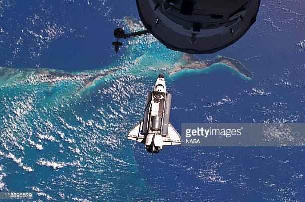 In this handout image provided by the National Aeronautics and Space Administration , NASA space shuttle Atlantis in Earth orbit seen over the...