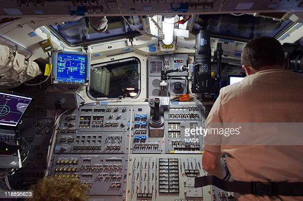 In this handout image provided by the National Aeronautics and Space Administration NASA astronaut Rex Walheim STS135 mission specialistworks at a...