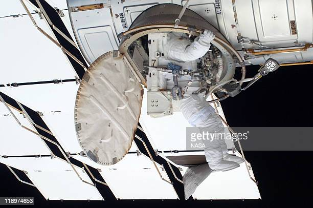 In this handout image provided by the National Aeronautics and Space Administration NASA astronaut Ronald Garan egresses the Quest airlock on the...