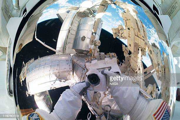 In this handout image provided by the National Aeronautics and Space Administration NASA astronaut Mike Fossum Expedition 28 flight engineer makes a...