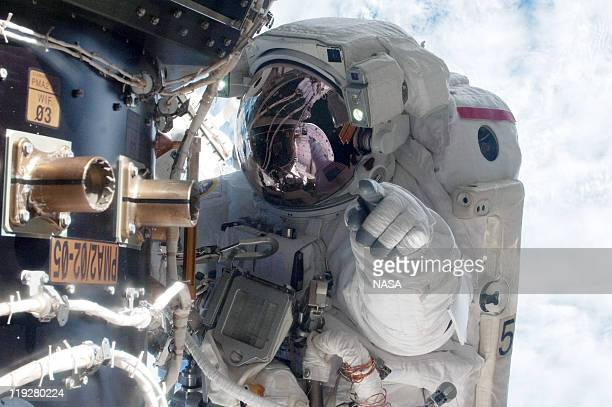 In this handout image provided by the National Aeronautics and Space Administration , NASA astronaut Mike Fossum, Expedition 28 flight engineer,...