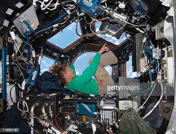 In this handout image provided by the National Aeronautics and Space Administration , NASA astronaut Sandy Magnus mission specialist for space...