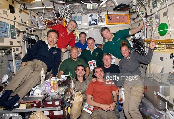 In this handout image provided by the National Aeronautics and Space Administration space shuttle Atlantis STS135 crew NASA astronauts Chris Ferguson...