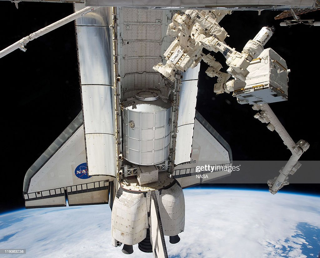 In this handout image provided by the National Aeronautics and Space Administration (NASA), NASA space shuttle Atlantis' cargo bay holds the Raffaello multi-purpose logistics module seen from the International Space Station before the two spacecraft undocked July 18, 2011 in space. The object connected to the station at right in the grasp of Dextre, a robot hand, is the Cargo Transport Container-2 (CTC-2) which was delivered by JAXA's HTV-2 vehicle earlier in the year. Space shuttle Atlantis is on the last leg of a 12-day mission to the International Space Station where it delivered the Raffaello multi-purpose logistics module packed with supplies and spare parts. This was the final mission of the space shuttle program, which began on April 12, 1981 with the launch of Colombia.