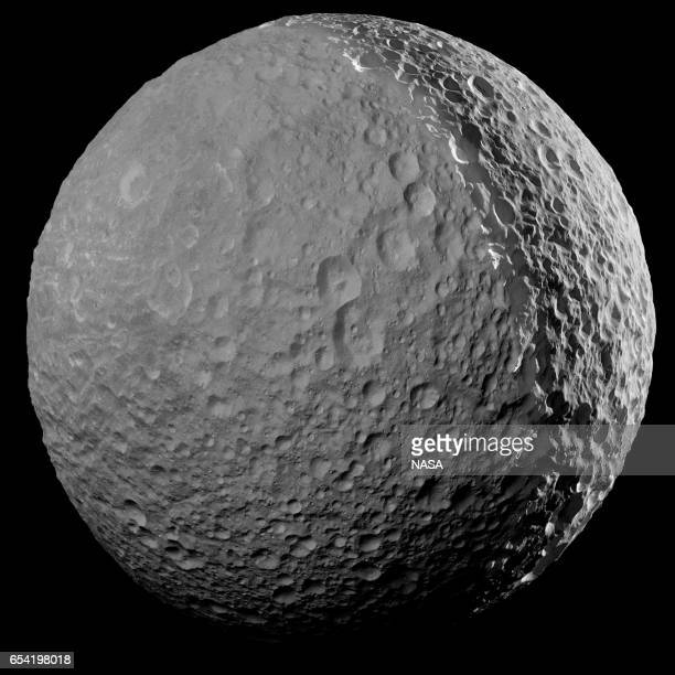 In this handout image provided by the National Aeronautics and Space Administration the planet Saturn's Death Star moon Mimas is shown from a...