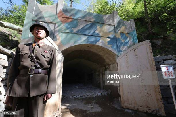 In this handout image provided by the News1DongA Ilbo a North Korean soldier stands at the entrance to a tunnel at the Punggyeri nuclear test site on...