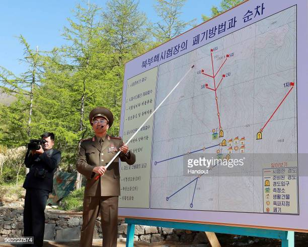 In this handout image provided by the News1-Dong-A Ilbo, a North Korean soldier explains the demolition process of the Punggye-ri nuclear test...