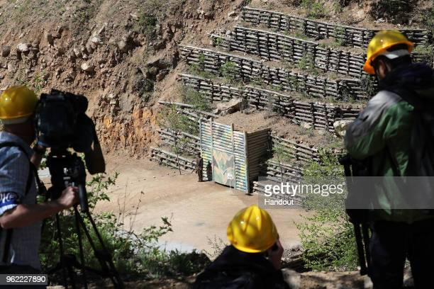 MAY 24 In this handout image provided by the News1DongA Ilbo members of the media watch before the demolition of the Punggyeri nuclear test site on...