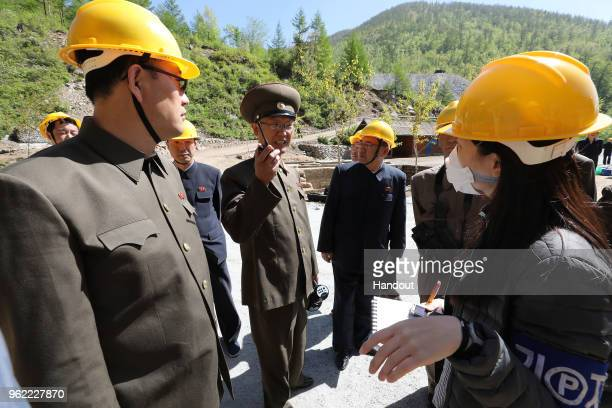 In this handout image provided by the News1DongA Ilbo North Korean officials talk with the media at the demolition of the Punggyeri nuclear test site...