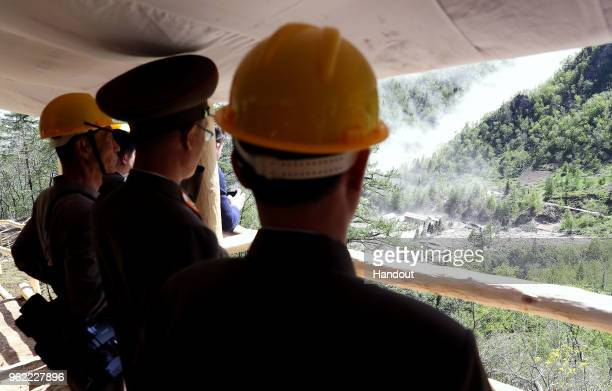 In this handout image provided by the News1DongA Ilbo North Korean officials watch the demolition of the Punggyeri nuclear test site on May 24 2018...