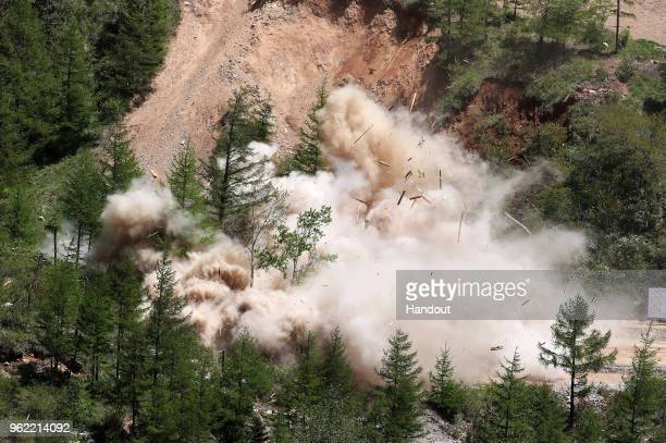 In this handout image provided by the News1DongA Ilbo taken on May 24 North Korea's Punggyeri nuclear test site explosion on May 24 2018 in Punggyeri...