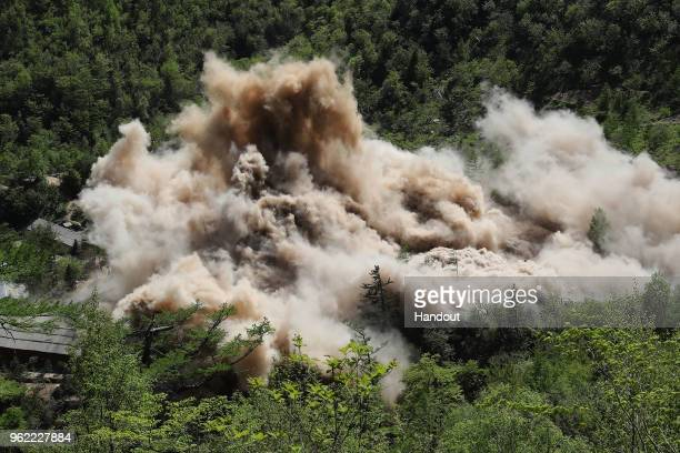 MAY 24 In this handout image provided by the News1DongA Ilbo the Punggyeri nuclear test site is demolished on May 24 2018 in Punggyeri North Korea...