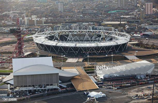 In this handout image provided by the Olympic Delivery Authority an aerial view looking west reveals a view of the Olympic Stadium the Aquatics...