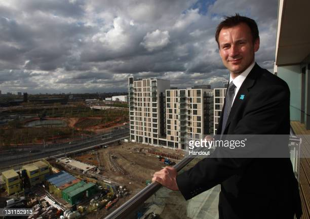 In this handout image provided by the Olympic Delivery Authority Culture Secretary Jeremy Hunt views the progress during a visit to Olympic Village...