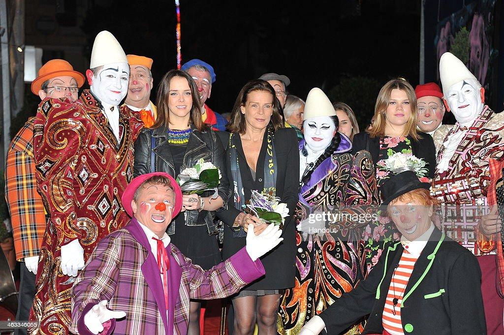 In this handout image provided by the Palais Princier de Monaco, Pauline Ducruet (L) and Princess Stephanie of Monaco (C) attend the 38th International Circus Festival on January 17, 2014 in Monte-Carlo, Monaco.