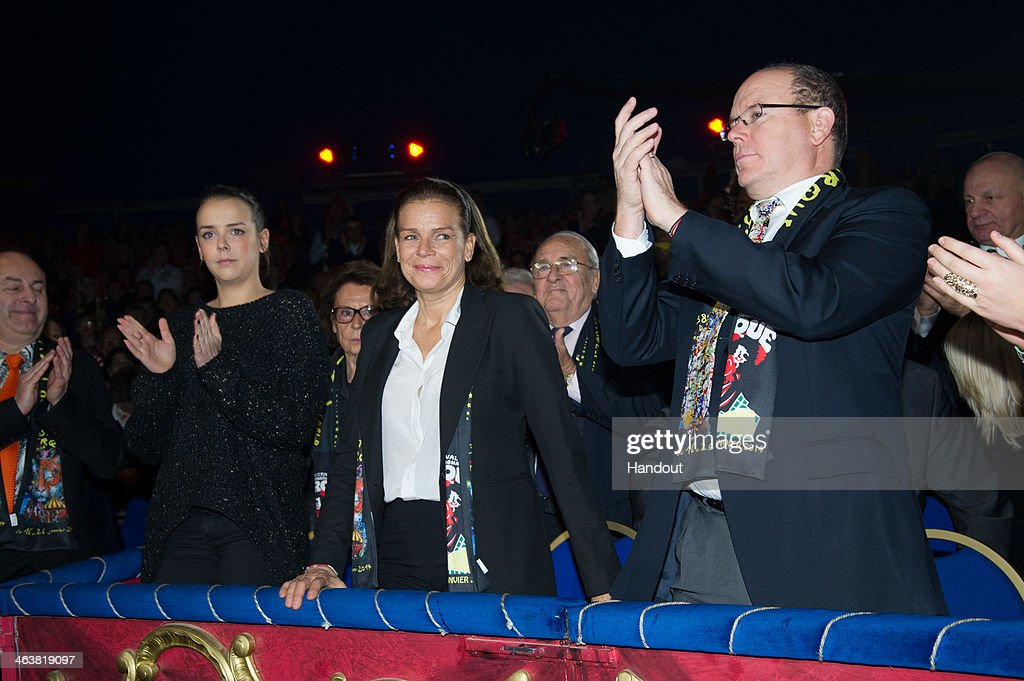 In this handout image provided by the Palais Princier de Monaco, Pauline Ducruet (L), Princess Stephanie of Monaco (C) and Prince Albert II of Monaco attend the 38th International Circus Festival on January 19, 2014 in Monte-Carlo, Monaco.