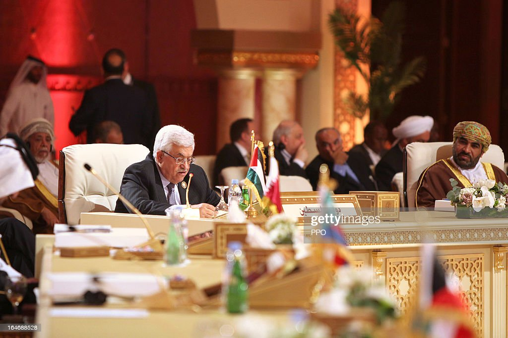 In this handout image provided by the Palestinian Presidents Office (PPO), Palestinian President Mahmoud Abbas delivers his speech during the 24th Arab Summit on March 26, 2013 in Doha, Qatar. The heads of State arrived for the summit today and were greeted by the Emir of Qatar Hamad bin Khalifa Al Thani, who is hosting the summit.