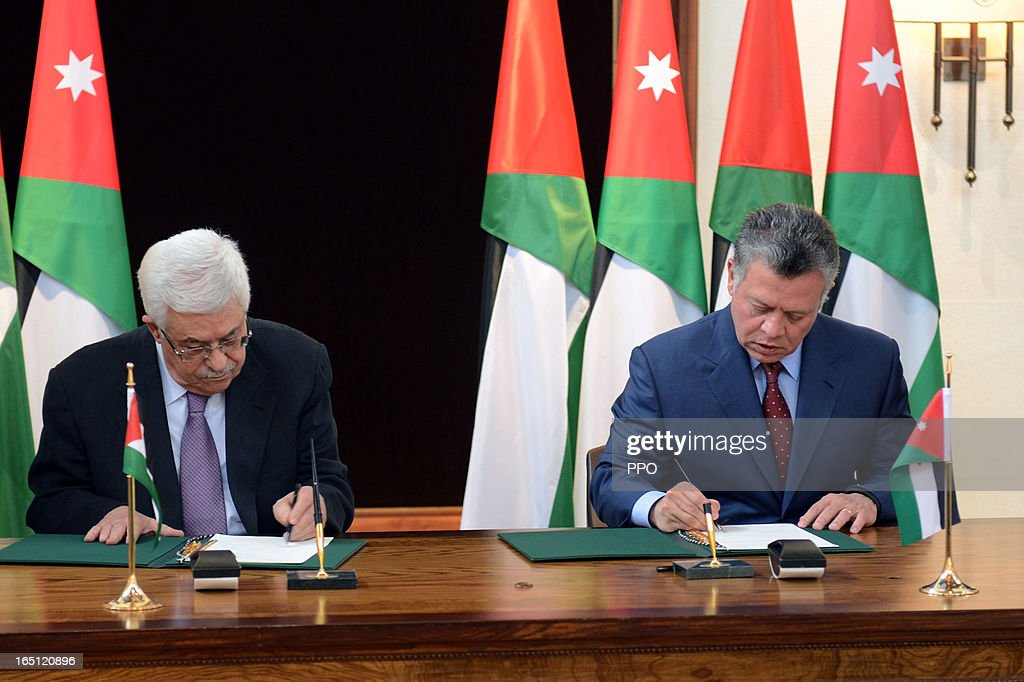 In this handout image provided by the Palestinian Presidents Office (PPO), Palestinian President Mahmoud Abbas and his Majesty King Abdullah II to sign an agreement to defend Jerusalem and it's Islamic and Christian holy sites on March 31, 2013 at The Royal Palace on March 31, 2013 in Amman, Jordan.